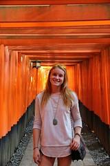 Through the Tunnel (Lindsay Shanley) Tags: me self selfportrait portrait fox buddhism tokyo fushiminari orange color temple shrine kyoto japan
