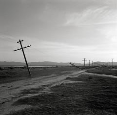 Outside of Winnemucca, Nevada (austin granger) Tags: film train silent desert symbol nevada tracks fallen electricity bleak disconnected bent metaphor telephonepoles equivalent desolate failed winnemucca correspondence gf670 austingranger