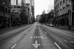 One Way This Way (KVanEmburgh) Tags: seattle street city urban blackandwhite washington nikon downtown northwest streetphotography streetscene april arrow nikkor kv emptystreet busroute downtownseattle citystreet whiteandblack urbanscene streetarrow nikond700 kvanemburgh kevinvanemburgh