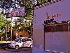 Lim's Market / Lee Sing Co. (rickele) Tags: graffiti rust peeling tag faded neonsign sacramento ghostsign klog steelsign limsmarket kloger leesingco