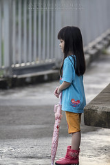 Walking after rain (Alphone Tea) Tags: life light shadow portrait favorite orange playing motion black blur cute green wet water girl beautiful smile rain childhood closeup kids composition contrast umbrella pose print children fun happy photography evening daylight photo amazing model singapore asia pretty alone bright little sweet bokeh modeling outdoor walk great models chinese young longhair adorable run age after lovely 70200 naturalight 2013 60d 70200f28lisiiusm