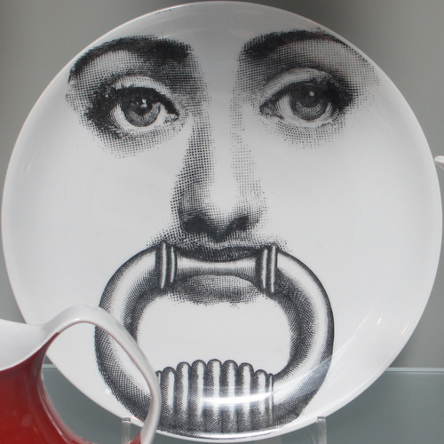 Lady with an heurtoir in her mouth - plate in the V&A
