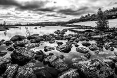 Rocky Ground (Jens Haggren) Tags: olympus em1 rocks water sky clouds snow summer fulufjllet dalarna sweden
