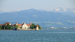 Lake Constance, Lindau (Debarshi Ray) Tags: germany lindau lake constance camera summer blue alps water sky mountains snow green trees house canoneos70d