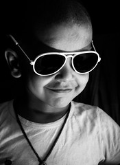 A Child Never Fakes A Smile (Capturing desire) Tags: child childphotography children childhood portrait natural light naturallight blackandwhite bw lightroom portraits filteredlight indoor home smile rahultripathi capturingdesire