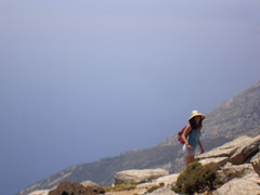 The very relaxed  girl we followed through the cliffs (isl_gr (Mnesterophonia)) Tags: girl hiker aegean greece strawhat atheras may erifi pezi cliffs ikarians hikingtrails   rockscape