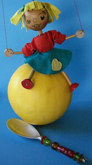 Catch Me! (Rand Luv'n Life) Tags: odc our daily challenge spoon glass beads pelham puppet polychrome yellow melon blue background catch falling heart love cheerful indoor composition