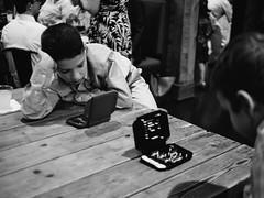 Battleship (BurlapZack) Tags: olympusomdem5markii panasonicleicadgsummilux25mmf14 vscofilm pack06 dallastx garlandtx wedding reception lakewoodbrewingcompany brewery kids battleship game tabletopgame bored bw mono monochrome hasbro table youngsters availablelight handheld bokeh dof