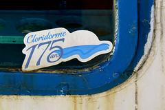 Cloridorme's 175th anniversary sticker on a fishing boat in the harbour of Cloridorme, Qubec (Ullysses) Tags: cloridorme175 cloridorme qubec canada summer t gaspesie fishingboat bateaudepeche window fenetre hautegaspesie sticker autocollant