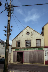 The house is elegant no more (Keith_Prefect) Tags: blue ireland sky abandoned sign shop town decay cork pole weathered bantry boarded 2013