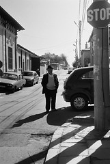 Parallel (MihaiPetre) Tags: street old white man black cars film sign analog photography shadows kodak 4 stop 200 fancy intersection kiev dacia 4a colorplus paralel