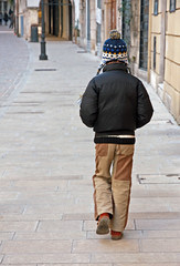 lonely child with jacket and wool Cap walk along the deserted road (federicofoto) Tags: road street family winter cold abandoned home childhood kids youth self walking skinny lost person town walks alone loneliness child free only lonely unhappy stroll abandonment isolated wander flee escaped autonomy vagabond orphaned