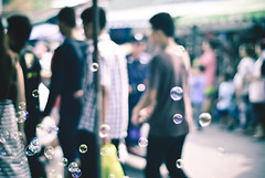 People, bubbles and bokeh! (HBW) (Angelo G.I.O.) Tags: life people sunlight blur streets colors wednesday walking thailand outside outdoors happy 50mm evening daylight nikon asia afternoon dof market bokeh availablelight bangkok bubbles daytime 18 naturalight eveninglight sukhumvit 50mm18 softtones peoplemoving jjmarket bokehlicious peopletogether d3000 happybokehwednesday nikond3000 beyondbokeh