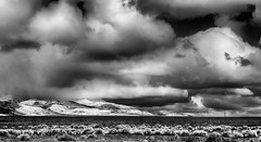 Dark and Stormy (jayvan) Tags: bw snow storm clouds landscape threatening hills poles drama sagebrush sonya77