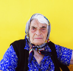 Portrait of a senior woman (similar) (Nasos Zovoilis) Tags: life old travel grandma portrait people woman brown white color film senior face look proud lady female scarf mediumformat hair greek happy person clothing women europe mediterranean european fuji village hand sad looking dress adult affection grandmother expression background character postcard teeth traditional country gray mother pride hasselblad greece human mature age experience elder older aged redneck balkans wisdom tradition cry middle granny joyful widow retired suffering aging wrinkles wrinkle isolated textured villager caucasian provia100