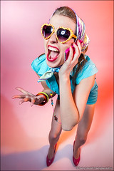 Funny young woman with telephone (Dmitry Mordolff) Tags: girls portrait people woman cute beautiful smile face sunglasses smiling fashion closeup laughing fun person one model glamour women funny phone looking view joy happiness human blond attractive only casual females emotional cheerful talking adults carefree 20s caucasian lifestyles 2025 ecstatic positivity expressing
