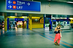 Lucy in the sky with diamonds (AvikBangalee) Tags: shop train waiting cellphone trainstation malaysia passenger kualalumpur publictransport signboard lrt facebook ticketcounter advertise bangsarlrtstation