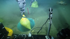 Deploying the first bag of glass beads into the caisson (Ocean Networks Canada) Tags: warning earthquake caisson sensor glassbeads barkleycanyon eews earthquakeearlywarning