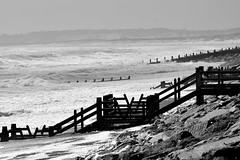 Wind and waves. (pstone646) Tags: nature sea blackandwhite weather water monochrome camber sussex storm beach coast view panorama breakwaters