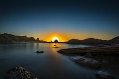 Sunset Bay (Jose L. Parra) Tags: arniabeach beach cantabria espaa europa landscape sky spain stone bay cliff longexposure rocks sun sunrise sunset water