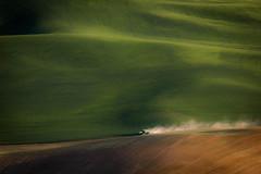 Tractor Trails (llabe) Tags: palouse dusk wheatfields dustyroad dust johndeere tractor steptoebutte steptoe washington nikon d40