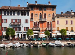 The old harbor of Desenzano with facades in typical Venetian style (Marythere *on/off*) Tags: desenzanodelgarda harbor architecture venetianstyle colorfulhouses