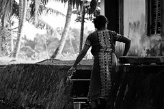 Canal Life (The Spirit of the World) Tags: bw dailylife india kerala southernindia palms trees palmtrees canal backwaters woman locals morning portrait