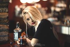 Irene and Jack. (Andrea Baldrati Photographer) Tags: portrait indoor restaurant italy italian woman girl model alcool jack daniels blonde smile smiling canon 6d 18 85