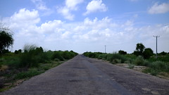 on the road to nagarparkar (shahmurai) Tags: fujifilmxt1 mithi nagarparkar thar sindh pakistan openroad road sky clouds