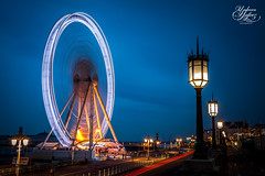 Brighton Wheel (Paki Nuttah) Tags: street uk blue light england car wheel night dark lights twilight brighton europe long exposure hove low trails ferris hour gb lamps