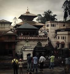 Pashupatinath Temple (© Jamie Mitchell) Tags: city nepal sunset portrait people man wet rain architecture religious temple pagoda religion holy monsoon ritual kathmandu nepalese himalaya shiva hindu hinduism mandir damp sadhu nepali pashupatinath pashupati bagmati