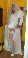 Bridal gown showing garter (Felicia Colette) Tags: stockings garter highheels lace transvestite weddingdress suspenders crossdresser bridalgown whitestockings tgurl tbride