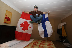 Kimi fan at the Canadian Grand Prix (scienceduck) Tags: 15fav canada june finland kimi hotel jump bed lotus quebec montreal flag motel wideangle f1 flags grandprix formulaone canadianflag fin formula1 qc pq 2013 royalbar bedjump canadiangrandprix finishflag pleaseserviceme