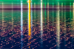 And columns of light rose up from the sea... (Anthony Plancherel) Tags: longexposure travel light sea seascape abstract art water night canon reflections turkey boat waves colours time turkiye transport places ripples category nightscenes reflectedlight erdek canon1585mm canon70d