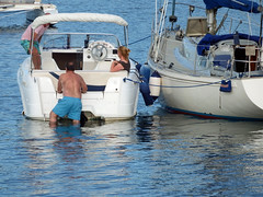 Climb aboard ! Poole, Dorset (Daves Portfolio) Tags: poole dorset boat trunks man inthewater boats harbour 2016