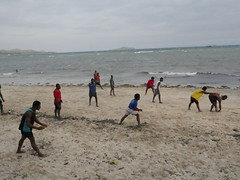 A soccer game at the beach
