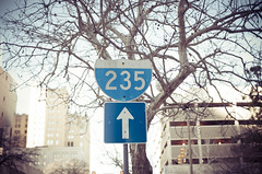 235 (MMortAH) Tags: 30mm america d90 nikon oklahoma sigma usa buildings road sign sunshine tree winter