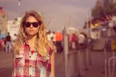 Prozac Rock (Kristen Palatella) Tags: girl model pretty beauty beautiful wind beach boardwalk nj newjersey pointpleasant ride rides fair pink blue sunglasses raybans blonde windy plaid