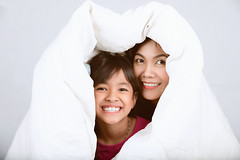 Daughter and mother (Patrick Foto ;)) Tags: adult affection asian background beautiful bed bedroom blanket child concept daughter day family female fun girl grey happiness happy home hugging indoors isolated joy kid laughing life lifestyle love lying mom morning mother mum parent people play playful portrait relaxing room smiling thai thailand together white woman young
