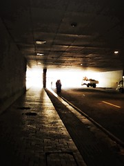 Like phantoms; from another world.... (tomk630) Tags: philippines sunrise tunnel traffic light brilliant otherworldly nature figures sidewalk