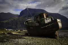 Run Aground (David C Laurie) Tags: trawler fishingboat abandoned fishing wreck shipwreck forgotten rot rotting hulk highlands fortwilliam corpach water beach sky outdoor landscape clouds rust rudder boat sad lowtide listing