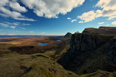 The Quiraing (Andy Watson1) Tags: uk travel blue sky people white holiday skye green water grass silhouette clouds canon landscape bay march scotland spring scenery view isleofskye britain plateau united great scenic scottish sigma kingdom na hills ridge british isle torridon trotternish landslip staffin quiraing meall of 450d suiramach