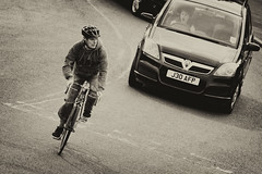dutch angle (arrowlili) Tags: woman man car bike bicycle sepia shadows helmet 365 yawning dutchangle odc