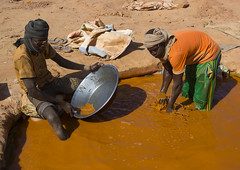 Men Searching For Gold, Alkhanag, Sudan (Eric Lafforgue) Tags: 2people africa alkhanag colorimage day dirt effort eri1575 gold goldpanning goldrush heat hope horizontal intoxication makingmoney male males men mercury metal mine miner mining nonurbanscene northafrica northsudan northernafrica northernsudan occupation outdoors pan panning people photography pollution preciousgem realpeople ruralscene saharadesert searching sudan teenager traveldestinations twopeople water soedan soudan        sudo szudn xuan