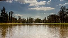 View from the footbridge, Cow Pond (markhortonphotography) Tags: park bridge blue sky cloud lake reflection water canon pagoda spring pond footbridge surrey 7d cowpond englefieldgreen queeneizabethii royallandscapes eos7d 1585mm henrywise thevalleygarden russcanning