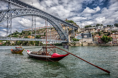 Oporto (Photos On The Road) Tags: old city travel bridge sky urban portugal water metal sailboat river outside outdoors boat ancient iron europa europe outdoor traditional fiume noone nobody nopeople landmark barche historic ponte porto cielo douro aged typical acqua viaggi hdr highdynamicrange oporto portogallo ferro nessuno tradizionale outdoorshots vilanovadegaia elaborazioni barcorabelo serradopilar pontedomluis singleexposurehdr outdoorshot domluisbridge flickrsfinestimages1 bestevercompetitiongroup hdrsingoloscatto distrettodioporto
