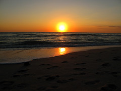 Beautiful Ending (Shamrockah) Tags: ocean sunset beach gulfofmexico waves peace florida horizon footprints sunny naples fireball twosuns swfl