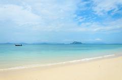 Lonely Paradise (ray_anthony) Tags: ocean travel sea sky holiday beach clouds thailand island boat sand nikon asia southeastasia paradise shore tropical longboat nikkor phuket islandlife d5100