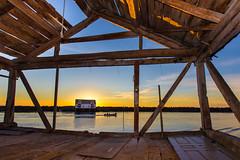 Trough the boat house (kjelljoran) Tags: sunset solnedgang sommer summer veiholmen smlanorge norway naust boathouse boat bt sky himmel hav ocean sea