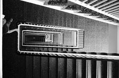 Globus II (maekke) Tags: zrich kreis1 stairs woman pointofview pov bw noiretblanc architecture urban fujifilm x100t 2016 ch switzerland streetphotography